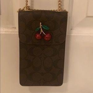 Coach mini cell phone carrier purse